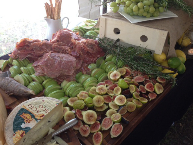 A sample catering spread at Andrea Trattoria Italiana in Millville, NJ, featuring figs, apples, and Italian cheeses and ham.