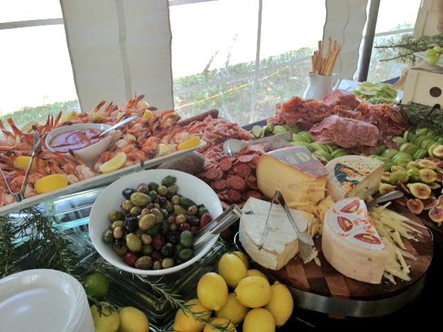 Catering spread at Andrea Trattoria Italiana II in Sea Isle City, NJ, featuring shrimp, olives, Italian cheeses and figs.